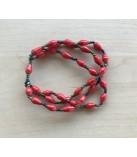 Røde papirsarmbånd på elastik
