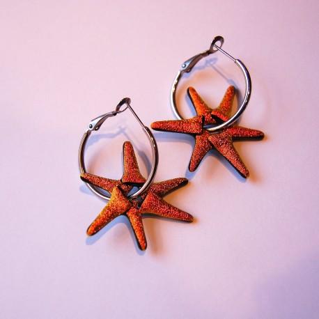 Orange stjerneøreringe på sølv